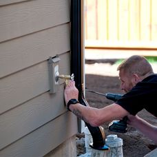 Man Installing downspout